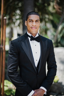 groom in custom tuxedo and textured jacket, bow tie