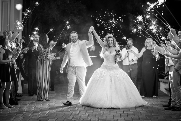 black and white photo of ashley alexiss and husband wedding grand exit sparklers