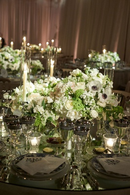 wedding reception tented ballroom low centerpiece white rose anemone ranunculus greenery tall candle