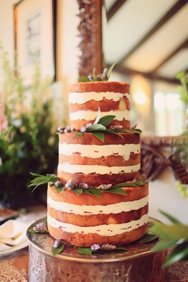 naked wedding cake with lavender and bay leaves
