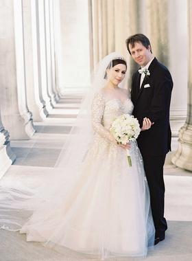 bride groom pose outside catholic church liancarlo wedding dress traditional calvin klein tuxedo