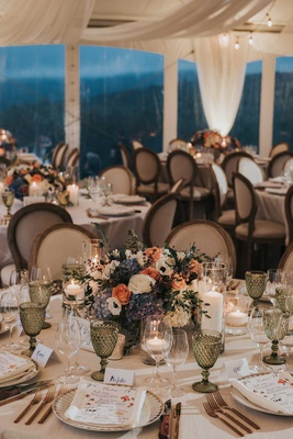 tented wedding reception french chair green goblets glassware white peach rose blue white hydrangea