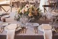 Lavender wedding table with round wood menus low flower arrangements anemone dahlia garden rose