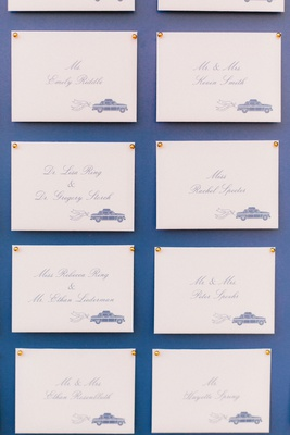 blue board with escort card calligraphy taxi theme find your seat gold push pins transportation