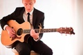 acoustic guitarist plays during wedding ceremony