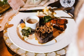 hearty german meal at rustic old-world old-europe reception featuring steak