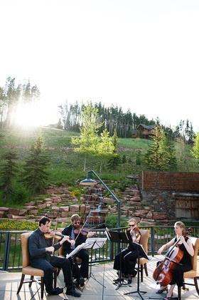 String quartet musicians playing at Big Sky, Montana wedding ceremony