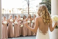 Bridesmaids face the beautiful bride as she presents her low back Ines Di Santo wedding dress