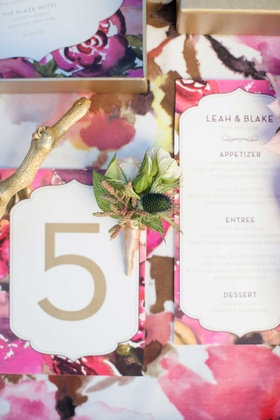 floral print inspired by coco chanel table linen white and gold calligraphy on wedding menu