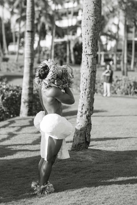 Black and white photo of destination wedding Hawaii ceremony with traditional conch shell performer