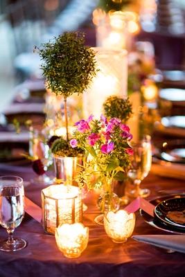 wedding reception long table purple linen candle votive green topiary barn decor rustic elegant