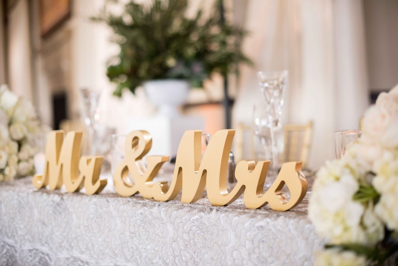 golden mr. and mrs. sign for wedding sweetheart table