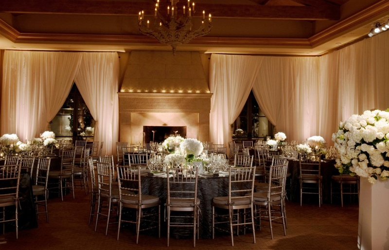 Round tables surrounded by silver chairs