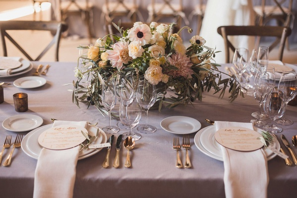 Lavender wedding table with round wood menus low flower arrangements anemone dahlia garden rose