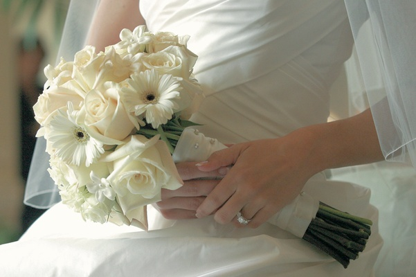 All-white bouquet wrapped in ribbons