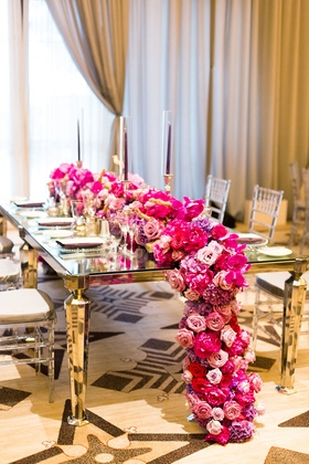 gold and silver glass tables with pink and purple floral table runner cascading spilling over