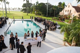 Wedding cocktail hour around pool poolside green lawn view of ocean