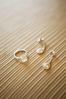 Princess-cut diamond engagement ring and drop earrings