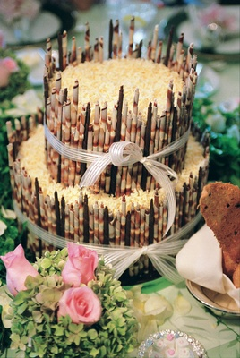 Two layer wedding cake with coconut and rolled chocolate details