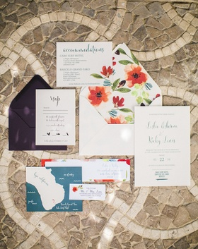 a couples colorful invitation suite featuring red blue green and purple design calligraphy