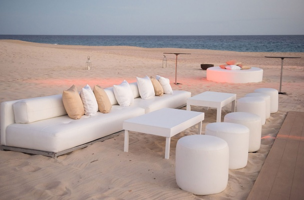 white lounge area on the beach for destination wedding in cabo san lucas