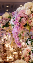 Wedding reception tall centerpiece purple orchid, white rose hydrangea, pink rose flowers floating