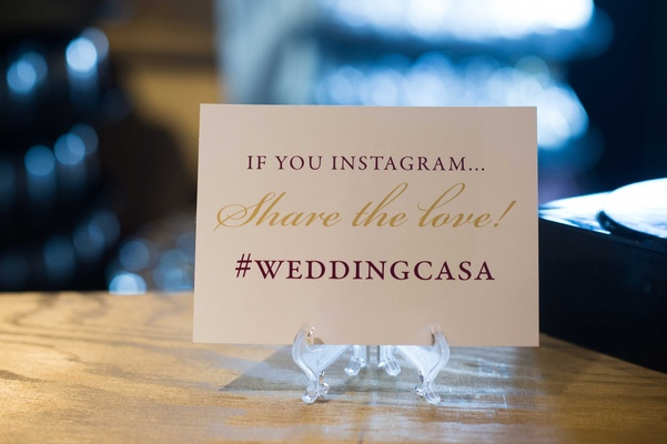 personalized hashtag on sign at wedding reception