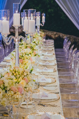 banquet tabes with patterned linens, crystal candelabra with pillar candles, white and pink florals