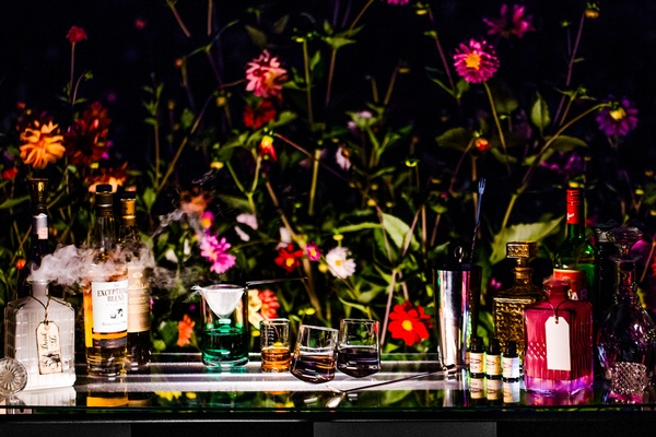 alice in wonderland inspired shoot, bar with potions decanter with dried ice that says drink me
