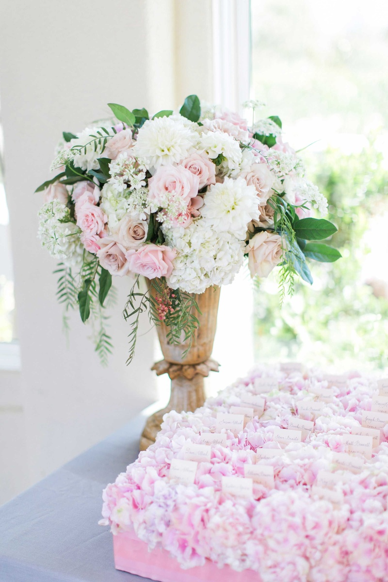 Reception dcor photos pink white flower arrangement at escort urn filled with white hydrangea pink rose and green leaves at escort card table mightylinksfo Gallery