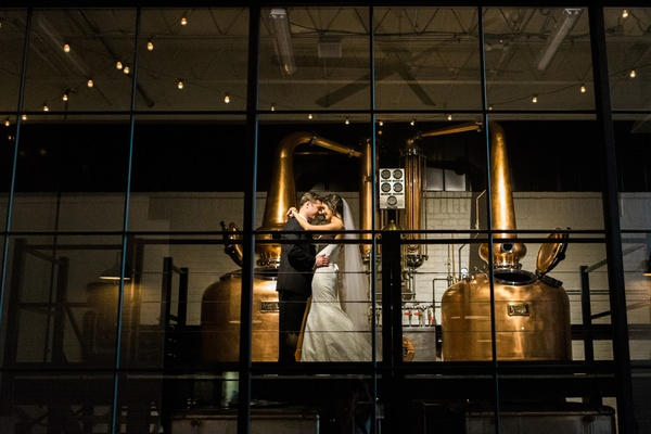 bride and groom alone in whiskey distillery