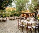 outdoor wedding reception at hummingbird nest ranch, courtyard reception, bistro lights