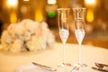 Bride and groom's champagne flutes with silver stems, crystals, and couple's names