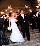 newlyweds pass through guests holding sparklers
