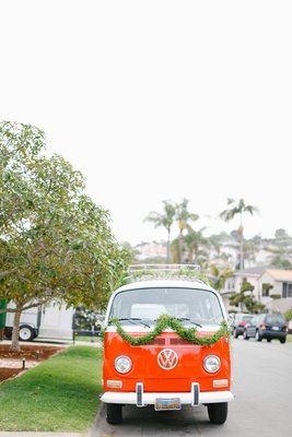 1971 Candy apple Red Volkswagen bus for couple and bridal party at waterfront wedding