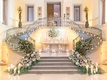 wedding reception grand staircase greenery muted flowers candles iron rail double staircase