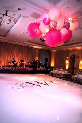 Wedding monogram on white floor in front of stage