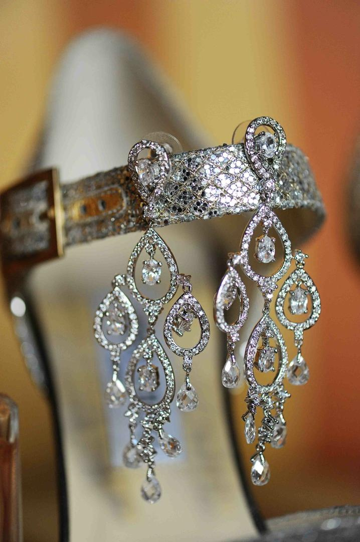 Sparkling crystal earring pair on silver shoes