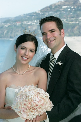 Bride with silver crown and groom in front of Laguna Beach