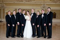 Bride and groom with tux groomsmen at The Breakers