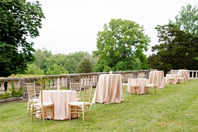 wedding reception cocktail tables on grass lawn high low tables pink linens gold chairs estate lawn