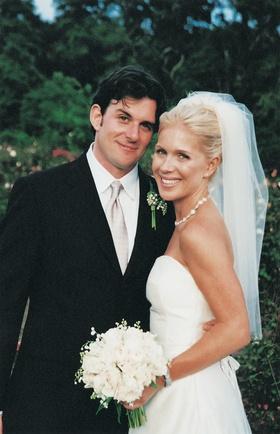 Blonde bride and brunette groom at wedding ceremony