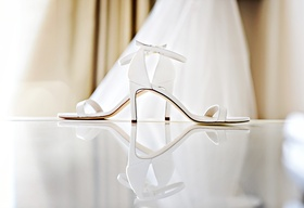 Stuart Weitzman wedding shoes sandals strappy ankle strap white bridal heels