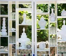 White vases and glasses on double-sided shelves