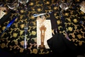 Wedding favor of a chocolate statuette dusted in 14K gold