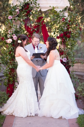 same-sex wedding, two brides, winnie couture gown, hayley paige gown, laughing during ceremony