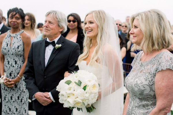 wedding ceremony taylour rutledge with mom and dad shane vereen mom in background outdoor ceremony
