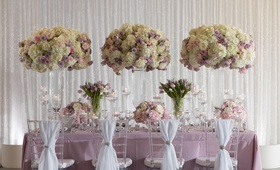 Wedding styled shoot inspiration purple linen white chair drapery tall flower arrangements purple