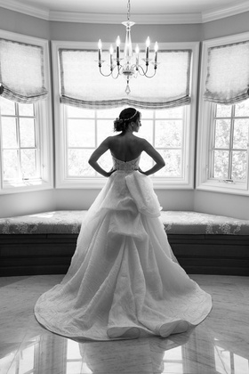 Black and white picture of back of Monique Lhuillier wedding dress
