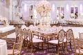 ballroom castle wedding oval back gold chairs crystal detail between table tall centerpiece royal